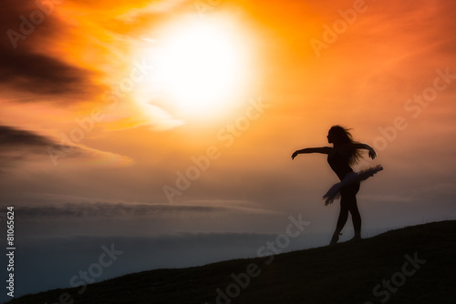 Foto op Canvas Dance School Ballerina silhouette, dancing alone in nature in the mountains a