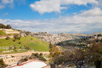 Kidron Valley in Jerusalem with snow and blue sky
