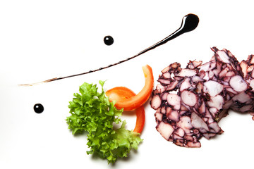 Octopus and vegetables with decorations of balsamic vinegar