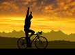 Silhouette of the cyclist riding a road bike at sunset - 81067459