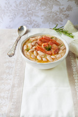 Baking dish with bean soup and fish