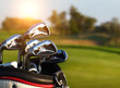 Golf clubs drivers over green field background - 81068029