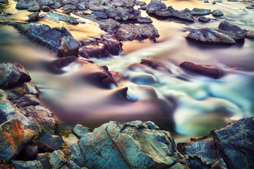 Colorful sunset water stream