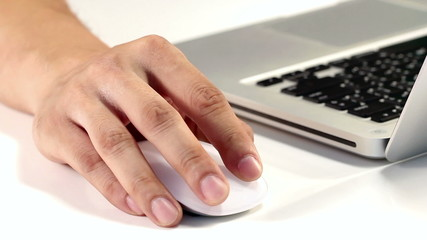 Male right hand click operates wireless computer mouse