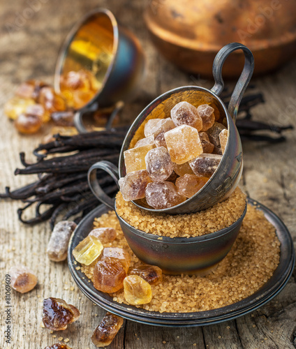 Brown and vanilla sugar on a background - 81069609