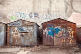 Fototapety  Old rusted locked garages with grungy graffiti