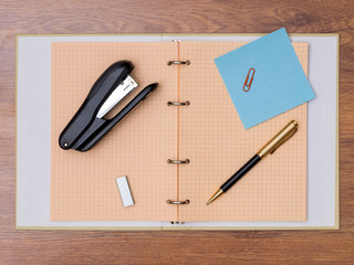 Notebook, pen, stapler and some other stationery
