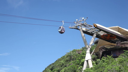 Cable car approaching a station on top of mountain