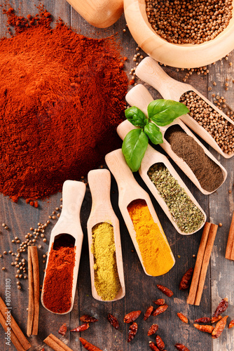 Variety of spices on kitchen table - 81071810
