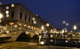Venice bridge over the canal in San Marco square area, at night