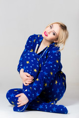 Beautiful girl siting in funny pajamas