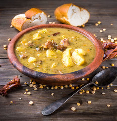 Pea soup with smoked chicken and herbs