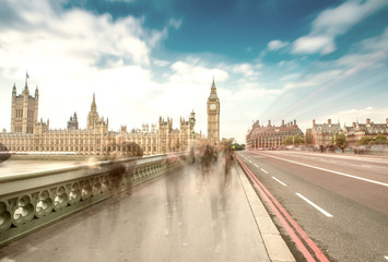 London. Blurred moving people along Westminster Bridge on a sunn