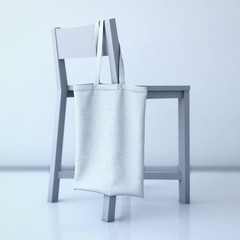 White cotton bag hanging on a chair. 3d rendering