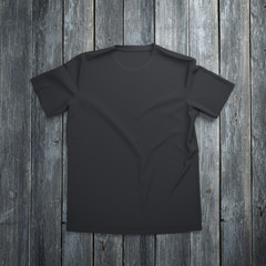Black t-shirt on wooden background