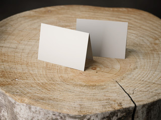 Two business cards on the stump