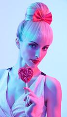Fashion girl portrait with Heart shaped big lollipop
