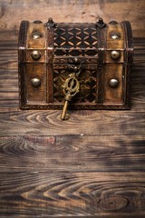 Lock. Closed decorative chest with old metal key