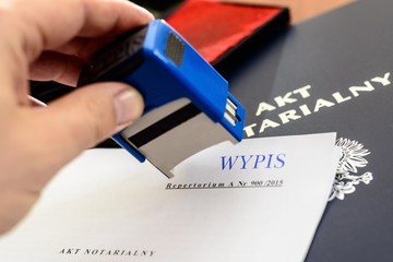 Notary gives stamp