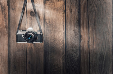 Old retro camera on vintage wooden planks