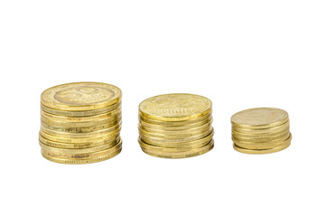 Three stacks of Ukrainian coins isolated on white