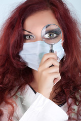 Nurse with magnifying glass