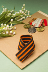 Victory Day. St. George ribbon, medals and flowers