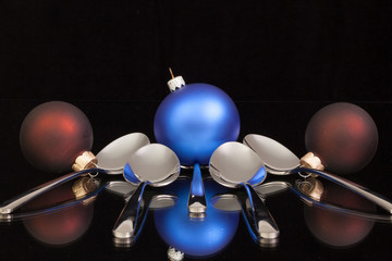 Blue Christmas decoration and five spoons