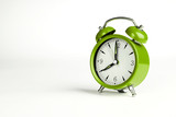 Eight o'clock. Green classic clock on white background.