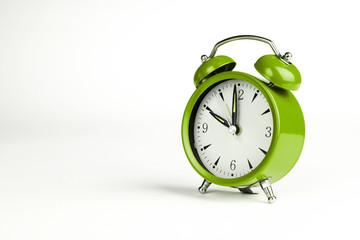 Ten o'clock. Green classic clock on white background.