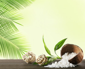 Sea salt in coconut shell on light background