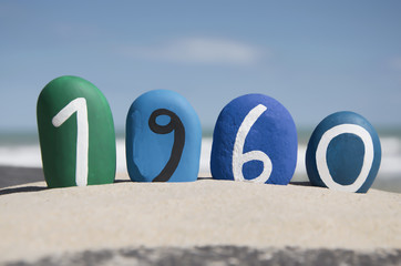 1960 year on colored stones on the sand