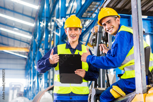 Worker and forklift driver in industrial factory - 81083273