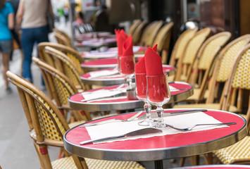 Montmartre restaurant with people walking
