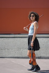 Biracial female violinist with violin, bow, and sunglasses