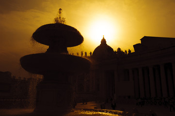 Piazza San Pietro (Saint Peter's Square) fountain silhouette.