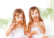 happy girl  twin sisters with lollipops candy