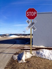 stop sign at railroad crossing