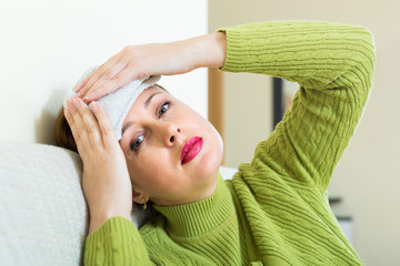 Female with wet towel on forehead