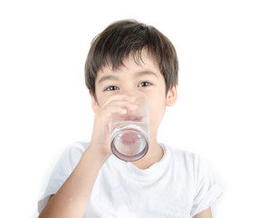 little asian boy drinks water from a glass