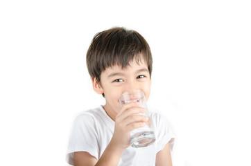 little asian boy drinks water from a glass