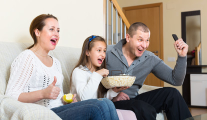 Family watching TV show
