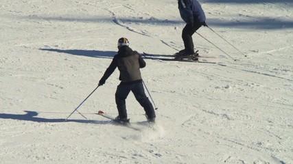 Falling skier who goes on ski track. Slow motion