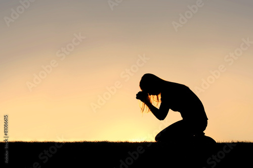Leinwanddruck Bild Christian Woman Sitting Down in Prayer Silhouette