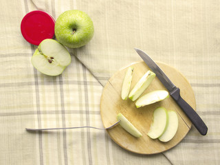 Apple sliced ingredient on chopping board