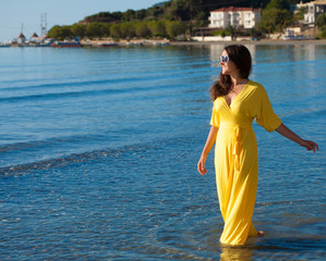 Woman with long yellow dress