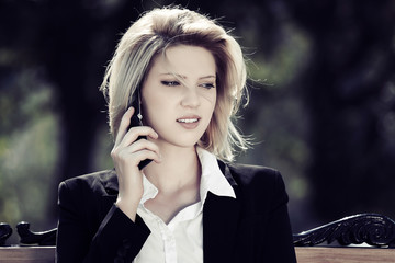 Fashion business woman calling on the cell phone outdoor