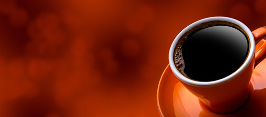 Cup of black coffee on bokeh background. Banner of a cup of