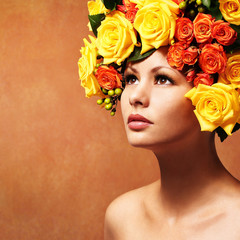 Woman with Yellow Roses. Model Girl with Flowers Hair. Fashion