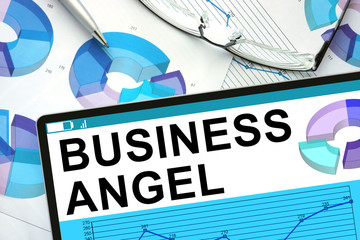 Business Angel on tablet with graphs. Business concept.